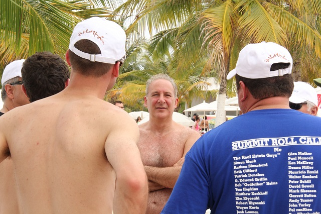 Peter Schiff talks with investors at the Investor Summit at Sea beach party