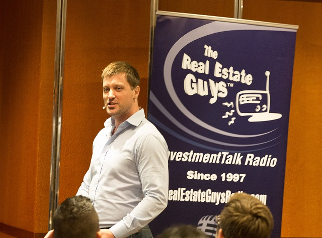 Sovereign Man Simon Black shres investing strategies aboard The Real Estate Guys Investor Summit at Sea featuring Robert Kiyosaki