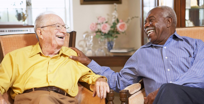 Two men enjoy fellowship in an assisted living home
