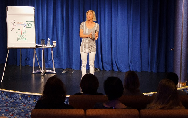 Kim Kiyosaki sharing in a women's breakout aboard The Real Estate Guys Summit at Sea
