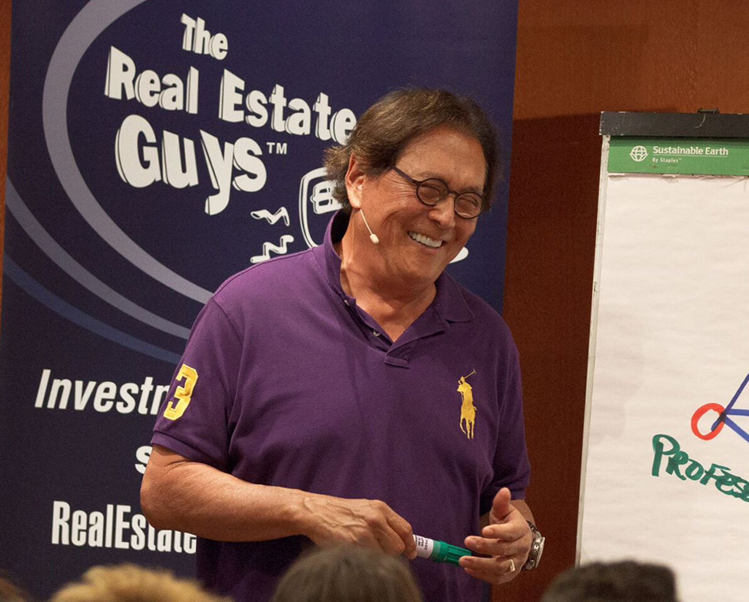 Rich Dad Poor Dad author Robert Kiyosaki teaches on The Real Estate Guys Investor Summit at Sea